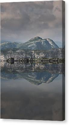 Mountain Reflection Canvas Print by Andy Astbury