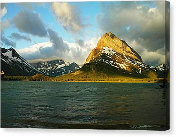 Mountains At Many Glacier Canvas Print by Jeff Swan