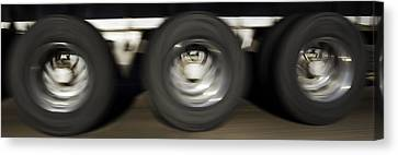 Moving Wheels Canvas Print by Miguel Capelo