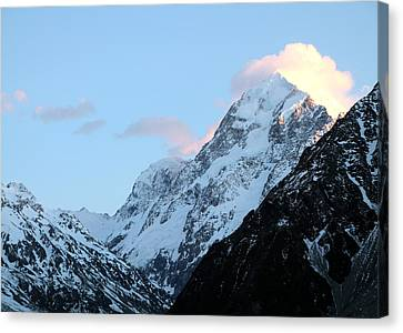 Canvas Print featuring the photograph Mt. Cook With Sunlit Clouds by Laurel Talabere