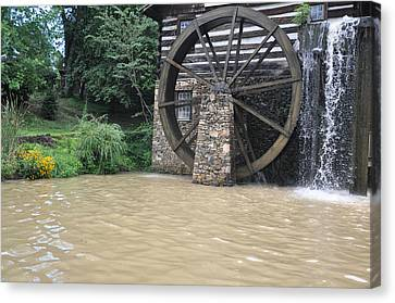 Muddy Water After The Rain Canvas Print by Jan Amiss Photography