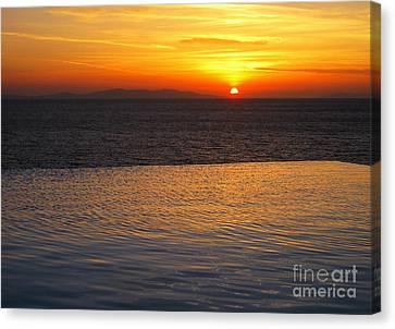 Mykonos Sunset Canvas Print by Leslie Leda