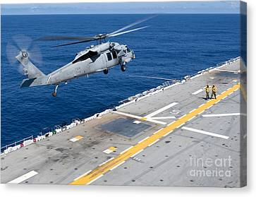 N Mh-60s Sea Hawk Helicopter Lifts Canvas Print by Stocktrek Images