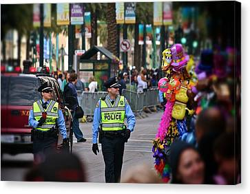 Canvas Print featuring the photograph New Orleans Police At Mardi Gras by Jim Albritton