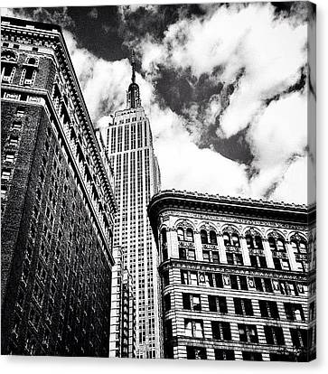 New York City - Empire State Building And Clouds Canvas Print by Vivienne Gucwa