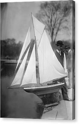 New York City, Man With Toy Yacht Canvas Print by Everett