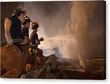 New York Firefighters Continue Canvas Print by Everett
