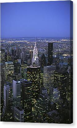 Night View Of The Manhattan Skyline Canvas Print by Todd Gipstein