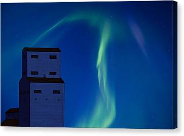 Northern Lights And Grain Elevator Canvas Print by Mark Duffy