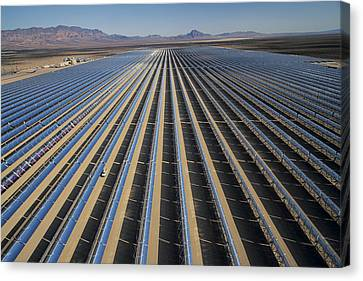 Oil Piped Down Long Rows Of Reflectors Canvas Print by Michael Melford