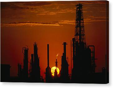 Oil Refinery Silhouetted Canvas Print by Paul Chesley