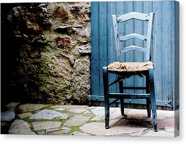 Old Blue Wooden Caned Seat Chair At Doorstep Canvas Print by Alexandre Fundone