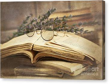 Old Books Open On Wooden Table  Canvas Print by Sandra Cunningham