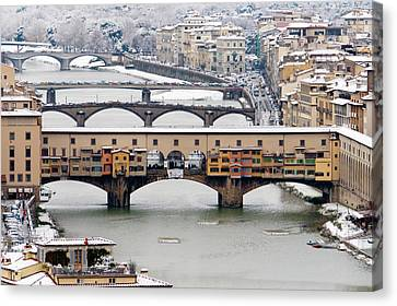 Old Bridge Under Snow Canvas Print by Guido Agapito