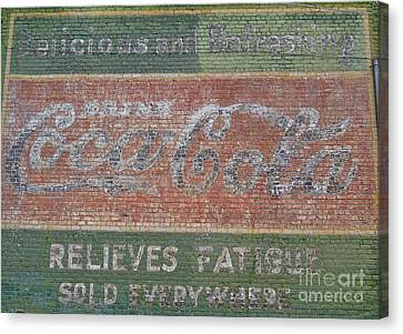 Canvas Print featuring the photograph Old Coca Cola Painted Brick Wall by Doris Blessington