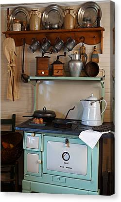 Old Cook Stove Canvas Print by Carmen Del Valle