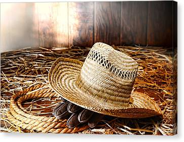 Old Farmer Hat In Hay Barn Canvas Print by Olivier Le Queinec