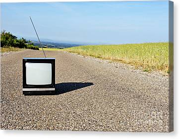 Old Country Roads Canvas Print - Old Fashioned Tv On Empty Countryside Road by Sami Sarkis