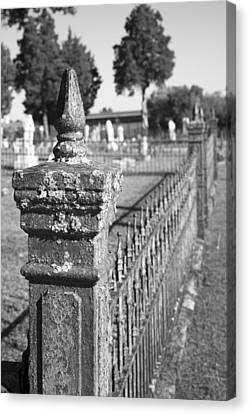 Old Graveyard Fence In Black And White Canvas Print by Kathy Clark