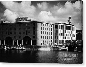 Old Historic Warehouse And The New Hilton Hotel At The Albert Dock Liverpool Merseyside England Uk Canvas Print by Joe Fox