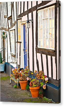 Old Houses Canvas Print by Tom Gowanlock