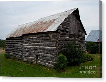 Canvas Print featuring the photograph Old Log Building by Barbara McMahon