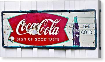 Old Metal Coke Sign Canvas Print by Susan Leggett