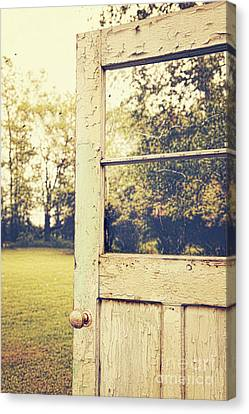Old Peeling Door With Landscape Canvas Print by Sandra Cunningham