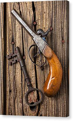 Old Pistol And Skeleton Key Canvas Print by Garry Gay