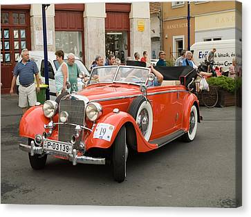 Old Red Car Canvas Print by Odon Czintos