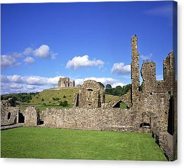 Old Ruins Of An Abbey With A Castle In Canvas Print by The Irish Image Collection