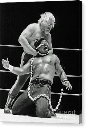 Canvas Print featuring the photograph Old School Wrestling Chain Match Between Moondog Mayne And Don Muraco by Jim Fitzpatrick