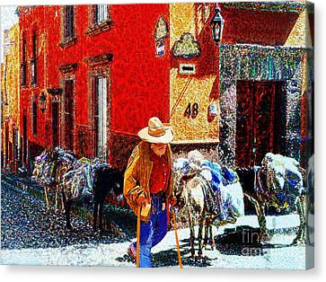 Old Timer With His Burros On Umaran Street Canvas Print by John  Kolenberg