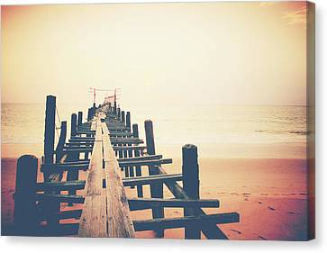 Old Wood Bridge To The Sea Canvas Print by Wanchai Yoosumran