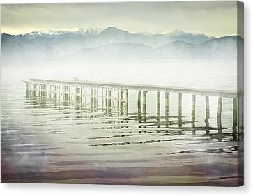 Old Wooden Bridge Into A Mountain Lake On A Foggy Morning Canvas Print by Joana Kruse