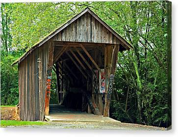 Old Wooden Covered Bridge Canvas Print by Susan Leggett