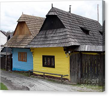 Canvas Print featuring the photograph Old Wooden Homes by Les Palenik