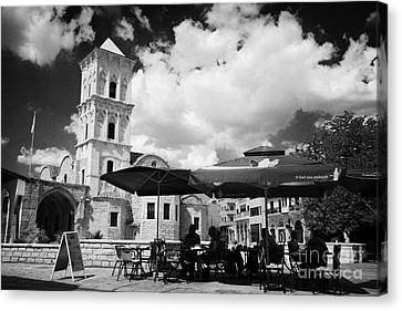 onstreet cafes at St Lazarus Church with belfry larnaca republic of cyprus europe Canvas Print by Joe Fox