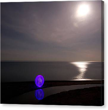Orb On The Beach Canvas Print by Cale Best