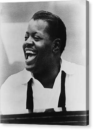 Oscar Peterson 1925-2007 At Piano Canvas Print by Everett