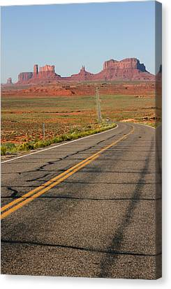 ouest USA route monument valley road Canvas Print by Audrey Campion