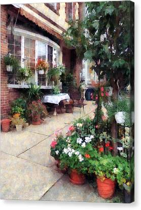 Outdoor Cafe With Flowerpots Canvas Print by Susan Savad