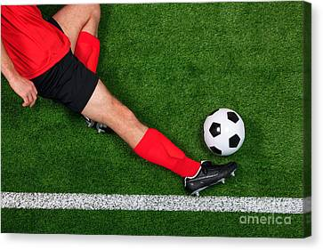 Overhead Football Player Sliding Canvas Print by Richard Thomas