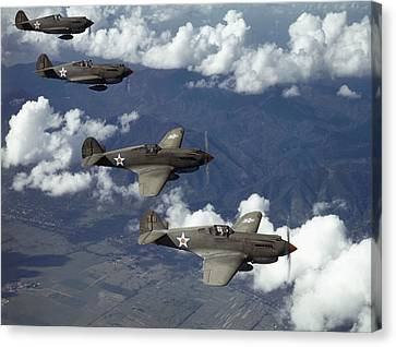 P-40 Pursuits Of The U.s. Army Air Canvas Print by Luis Marden