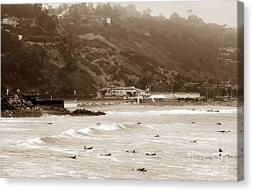 Paddling Out Canvas Print by John Rizzuto