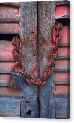Padlock And Chain On Wooden Door Canvas Print by Carson Ganci