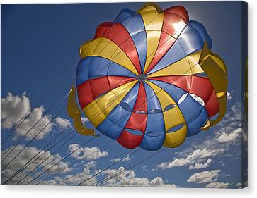 Parasail Backlit By Sun Mauritius Canvas Print by Stuart Westmorland
