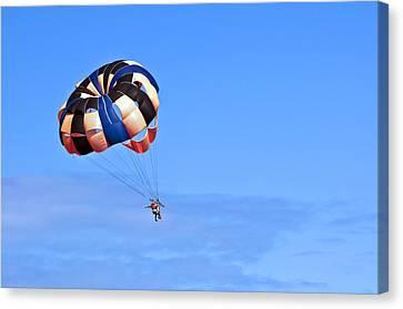 Parasailing Under Blue Sky. Canvas Print by Fernando Barozza