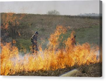 Park Workers Set A Controlled Fire Canvas Print by Annie Griffiths