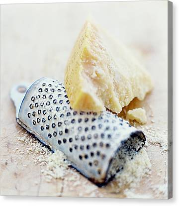 Parmesan Cheese And Grater Canvas Print by David Munns